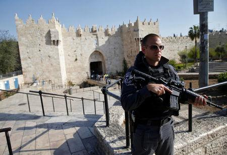 Israeli policeman stands guard near the scene of what Israeli police spokesperson said was an attempted stabbing attack at Damascus Gate in Jerusalem's Old City
