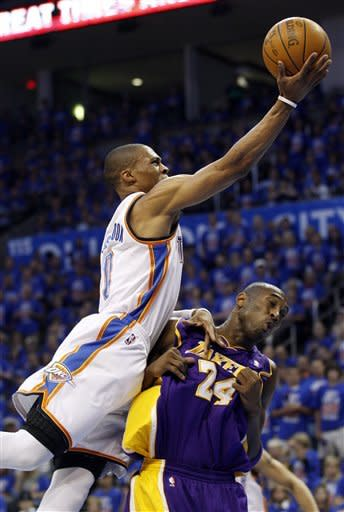 Oklahoma City Thunder guard Russell Westbrook (0) shoots over Los Angeles Lakers guard Kobe Bryant (24) in the first quarter of Game 5 in their NBA basketball Western Conference semifinal playoff series, Monday, May 21, 2012, in Oklahoma City. (AP Photo/Sue Ogrocki)