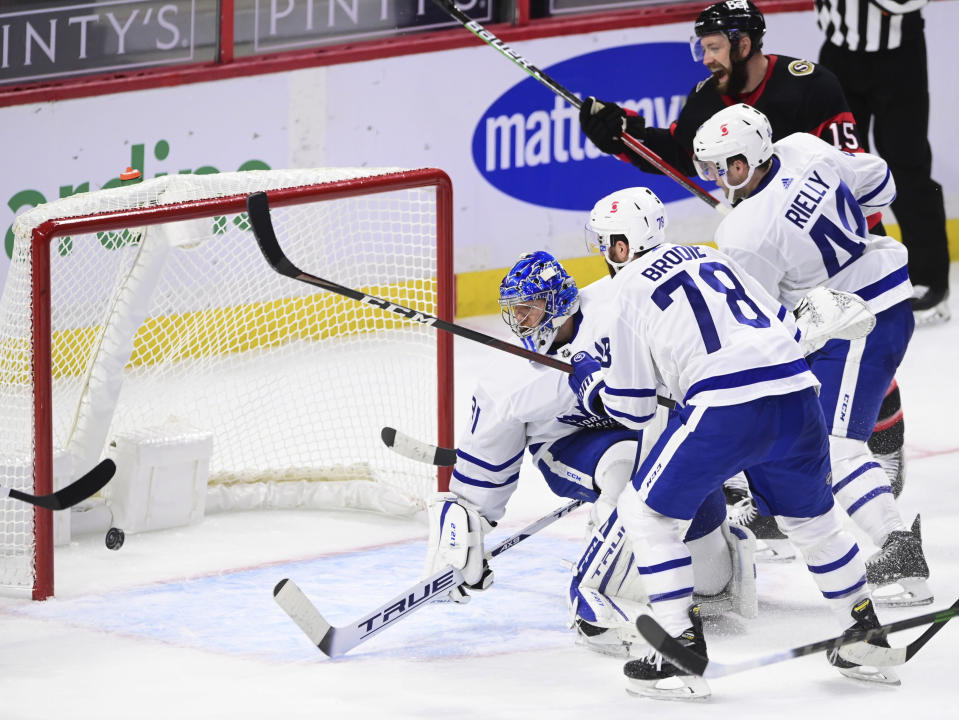Ottawa Senators Derek Stepan, top right, cheers a goal by Chris Tierney, not seen, on Toronto Maple Leafs goaltender Frederik Andersen (31) during the second period of an NHL hockey game Friday, Jan. 15, 2021, in Ottawa, Ontario. (Sean Kilpatrick/The Canadian Press via AP)