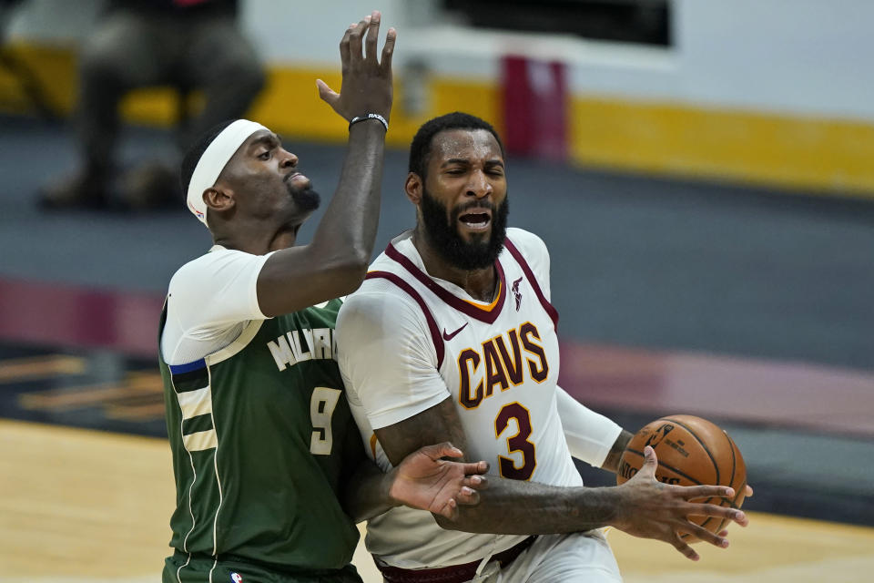 FILE - Cleveland Cavaliers' Andre Drummond (3) drives to the basket against Milwaukee Bucks' Bobby Portis (9) in the second half of an NBA basketball game in Cleveland, in this Saturday, Feb. 6, 2021, file photo. The NBA trading deadline came and went. Andre Drummond didn't move. Unable to find a trade partner Thursday, March 25, 2021, for the benched center, the Cavaliers will structure a contract buyout for the two-time All-Star center, who hasn't played since Feb. 12 and could wind up on a contending team after being pushed aside in Cleveland. (AP Photo/Tony Dejak, File)