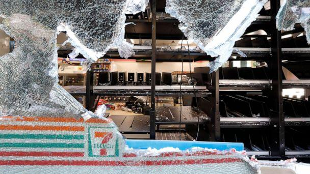 PHOTO: Shattered glass hangs from a window of a 7-Eleven store early, May 31, 2020, in Chicago, after a night of unrest and protests over the death of George Floyd, a black man who was in police custody in Minneapolis. (Charles Rex Arbogast/AP)