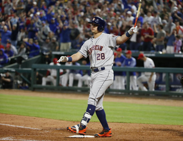 Houston Astros hitter J.D. Davis (28) strikes out on a pitch by Texas Rangers relief pitcher Alex Claudio, to end the sixth inning of a baseball game Friday, March 30, 2018, in Arlington, Texas. (AP Photo/Michael Ainsworth)