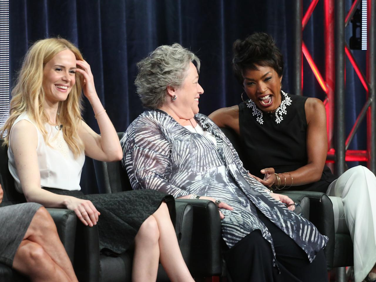 """BEVERLY HILLS, CA - AUGUST 02: (L-R) Actresses Sarah Paulson, Kathy Bates, and Angela Bassett speak onstage during the """"American Horror Story: Coven"""" panel discussion at the FX portion of the 2013 Summer Television Critics Association tour - Day 10 at The Beverly Hilton Hotel on August 2, 2013 in Beverly Hills, California. (Photo by Frederick M. Brown/Getty Images)"""