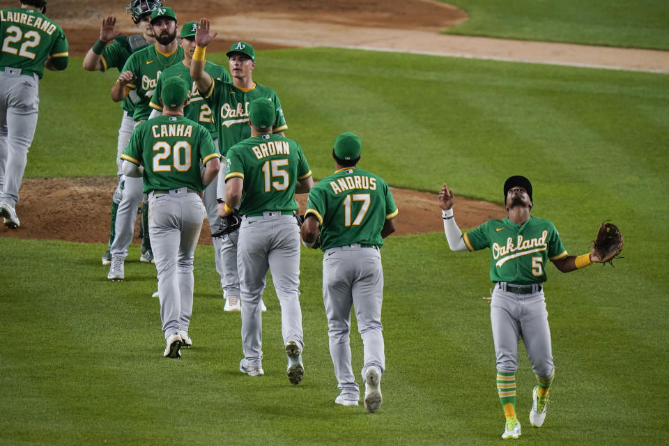 Oakland Athletics' Tony Kemp (5) celebrates with teammates after a baseball game against the New York Yankees on Friday, June 18, 2021, in New York. The Athletics won 5-3. (AP Photo/Frank Franklin II)