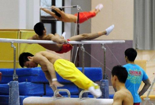 Gymnasts train for the 2012 Chinese Olympic team at the Sports Administration training centre