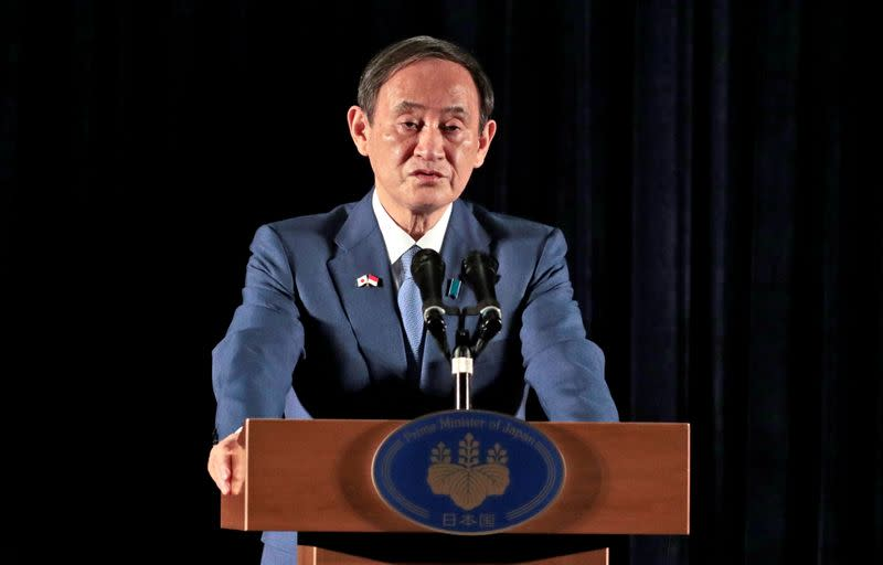 Japanese PM Suga speaks to the media during a press conference in Jakarta