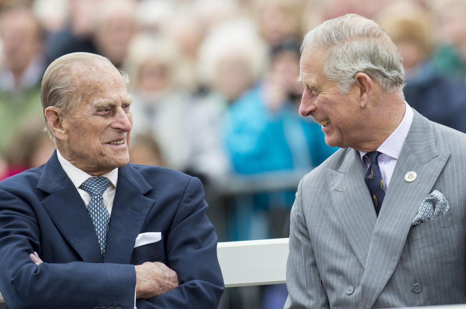 Prince Charles  and Prince Philip laughing together