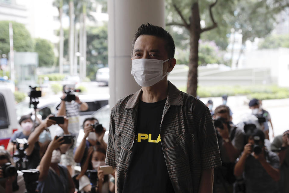 Hong Kong singer and pro-democracy activist Anthony Wong arrives at a court Thursday, Aug. 5, 2021. Wong who was charged with corrupt conduct for providing entertainment to voters to sway their votes in a by-election, had the charges dropped on Thursday. (AP Photo/Matthew Cheng)