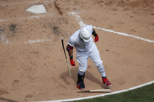 Texas Rangers' Rougned Odor smashes his bat on the ground after striking out against the Chicago White Sox during the fourth inning of a baseball game Sunday, Aug. 25, 2019, in Chicago. (AP Photo/Jeff Haynes)