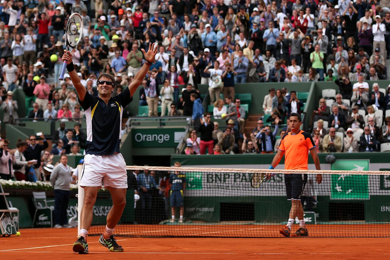 PARIS, FRANCE - JUNE 02:  Tommy Robredo of Spain celebrates match point during his Men's Singles match against Nicolas Almargo of Spain during day eight of the French Open at Roland Garros on June 2, 2013 in Paris, France.  (Photo by Clive Brunskill/Getty Images)