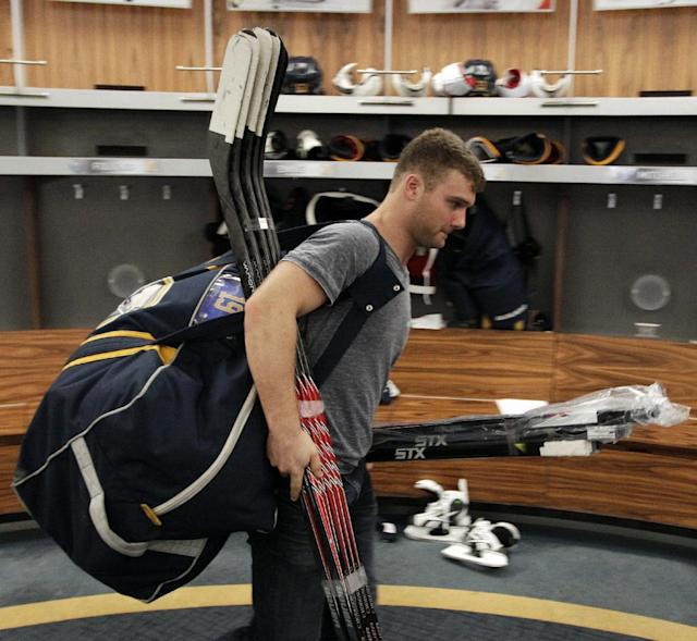 Buffalo Sabres center Cody Hodgson exits the Buffalo Sabres' locker room with his equipment after players gathered for the last time on Monday, April 14, 2014, after the NHL hockey team clinched the NHL's worst record, in Buffalo, N.Y. (AP Photo/Nick LoVerde)