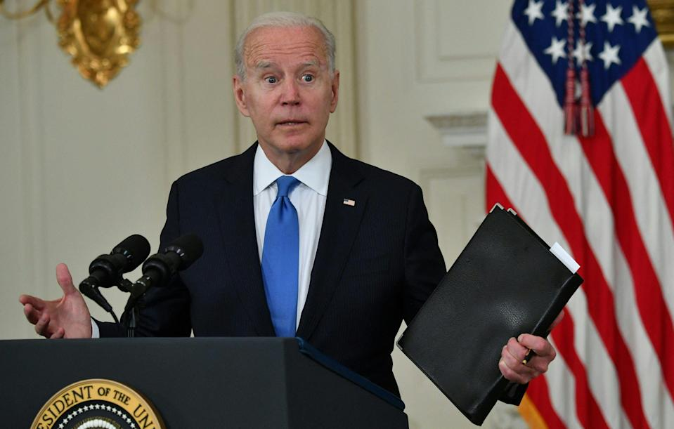 <p>US President Joe Biden delivers remarks on the American Rescue Plan in the State Dining Room of the White House on May 5, 2021.</p> (Photo by NICHOLAS KAMM/AFP via Getty Images)