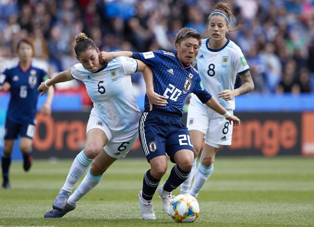 Aldana Cometti of Argentina competes for the ball with Kumi Yokoyama of Japan during the 2019 FIFA Women's World Cup France group D match between Argentina and Japan at Parc des Princes on June 10, 2019 in Paris, France. (Photo by Quality Sport Images/Getty Images)