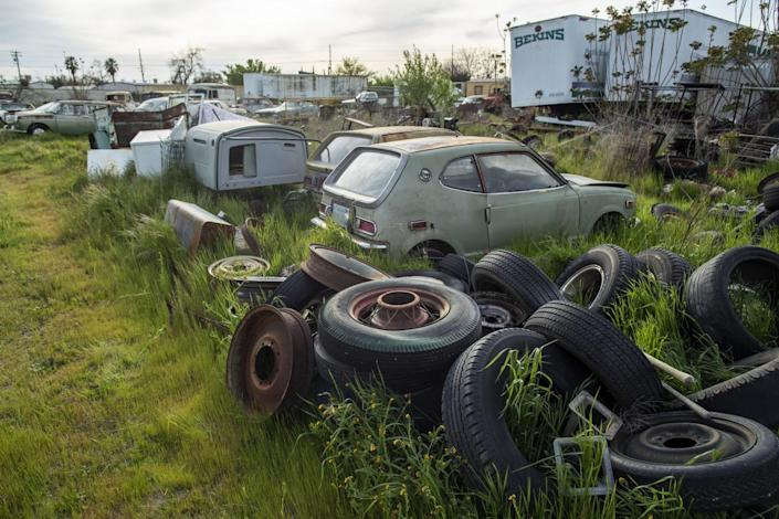 Old cars, junk and antiques sit in a lot in Turlock.