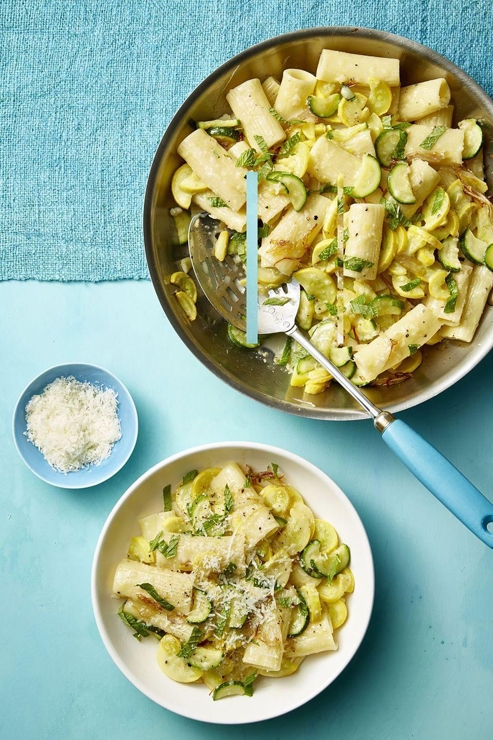 """<p>This filling dish works as both an entree or an appetizer, depending on your needs. </p><p><u><em><strong><a href=""""https://www.womansday.com/food-recipes/food-drinks/a21052788/summer-squash-mint-and-pecorino-pasta-recipe/"""" rel=""""nofollow noopener"""" target=""""_blank"""" data-ylk=""""slk:Get the recipe for Summer Squash, Mint, and Pecorino Pizza"""" class=""""link rapid-noclick-resp"""">Get the recipe for Summer Squash, Mint, and Pecorino Pizza</a>.</strong></em></u></p>"""