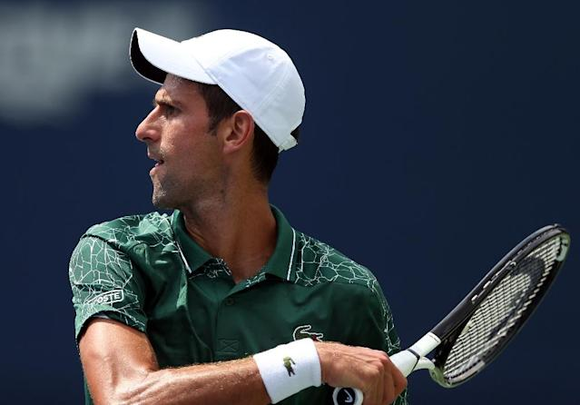 Novak Djokovic double-faulted while serving for his match against Mirza Basic, slipping into a second-set tie-break, but he finished the job for a second-round spot (AFP Photo/Vaughn Ridley)