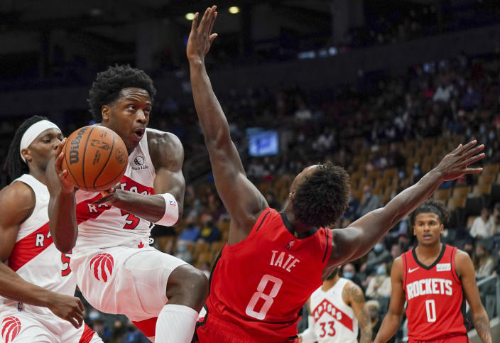Toronto Raptors forward OG Anunoby (3) is called for an offensive foul against Houston Rockets forward Jae'Sean Tate (8) during first-half preseason NBA basketball game action in Toronto, Monday, Oct. 11, 2021. (Evan Buhler/The Canadian Press via AP)
