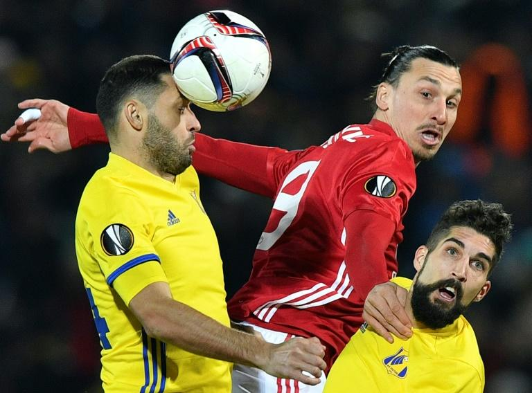 Manchester United's Zlatan Ibrahimovic (C) fights for the ball with Rostov's Aleksandr Gatskan (L) and Miha Mevlja during their UEFA Europa League round of 16 1st leg match, at Olimp-2 Arena in Rostov-on-Don, on March 9, 2017