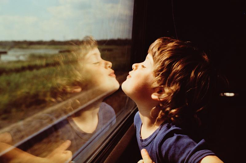 Child and Reflection in Window (Photo: PhoTon via Getty Images)