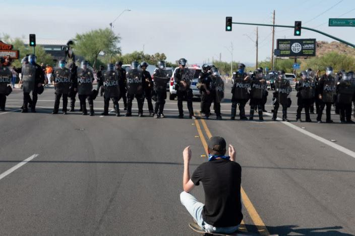 Police block protestors during the visit by U.S. President Donald Trump to the Dream City Church in Phoenix