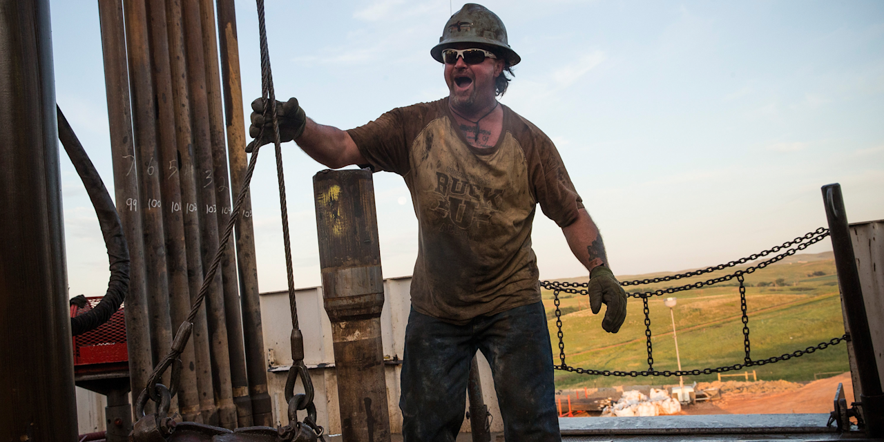 Glen Crabtree, a floor hand for Raven Drilling, smiles while drilling for oil in the Bakken shale formation on July 23, 2013 outside Watford City, North Dakota.