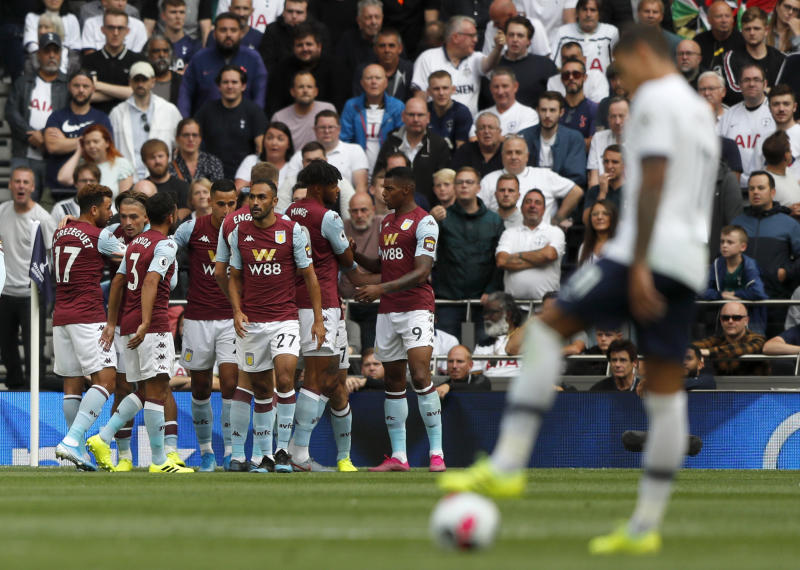 Aston Villa's John McGinn celebrates with teammates after scoring his side's opening goal during the English Premier League soccer match between Tottenham Hotspur and Aston Villa at the Tottenham Hotspur stadium in London, Saturday, Aug. 10, 2019. (AP Photo/Frank Augstein)