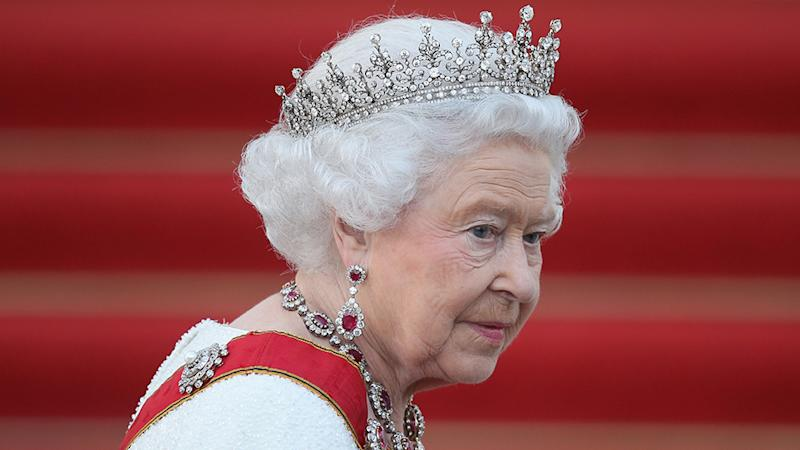 Queen Elizabeth II shares coronavirus message pictured on red carpet with tiara