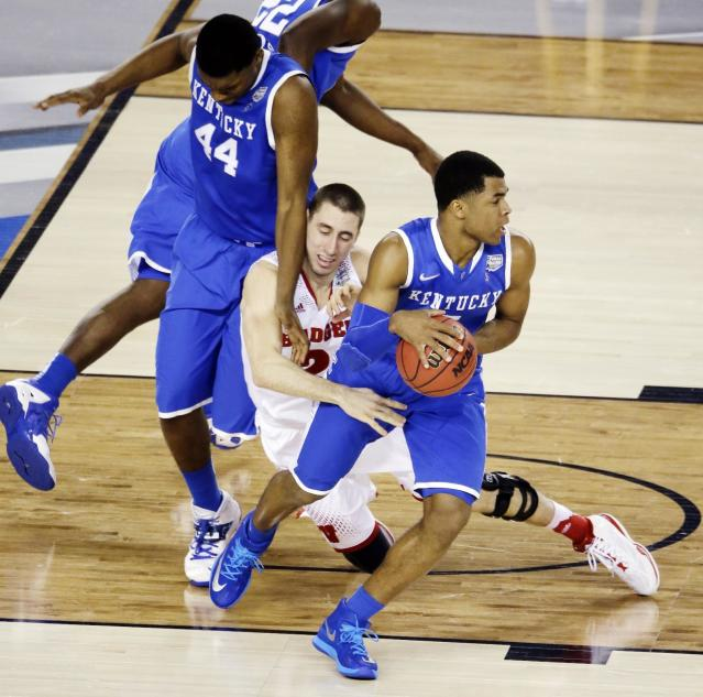 Kentucky guard Aaron Harrison (2) takes the ball from Wisconsin guard Josh Gasser (21) as center Dakari Johnson (44) defends during the first half of the NCAA Final Four tournament college basketball semifinal game Saturday, April 5, 2014, in Arlington, Texas. (AP Photo/Tony Gutierrez)