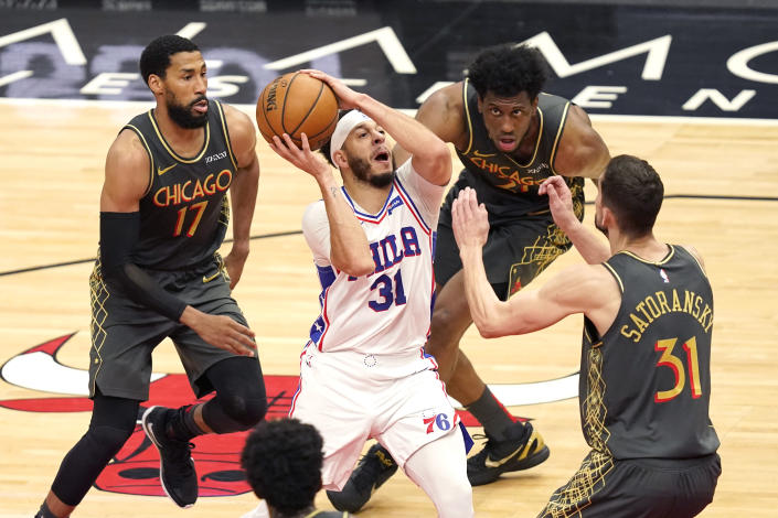 Philadelphia 76ers' Seth Curry (31) drives to the basket as Chicago Bulls forward Garrett Temple (17) Tomas Satoransky (31) and Thaddeus Young defend during the second half of an NBA basketball game Monday, May 3, 2021, in Chicago. (AP Photo/Charles Rex Arbogast)