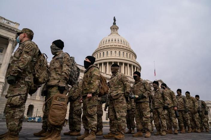 WASHINGTON, DC - JANUARY 11: National Guard member stage on the U.S. Capitol Building grounds, as heightened security measures are in place nearly a week after a pro-Trump insurrectionist mob breached the security of the nation's capitol while Congress voted to certify the 2020 Election Results on Monday, Jan. 11, 2021 in Washington, DC. (Kent Nishimura / Los Angeles Times)
