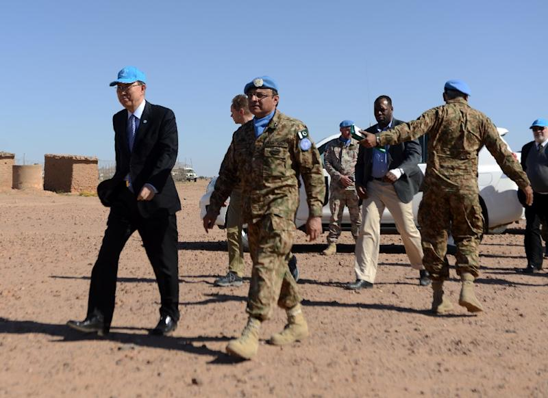 United Nations chief Ban Ki-moon (L) arrives for a meeting with the Polisario Front's representative at the UN, on March 5, 2016, near a UN base in Bir-Lahlou, in the disputed territory of Western Sahara