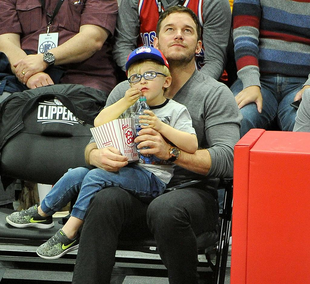 <p>The devoted dad carved out time to take his favorite boy, his son Jack, to see the Los Angeles Clippers play the Minnesota Timberwolves at Staples Center in L.A. on Wednesday. The <em>Jurassic World: Fallen Kingdom </em>star gave Jack courtside cuddles, as the cutie pie munched on some popcorn. (Photo: Allen Berezovsky/Getty Images) </p>