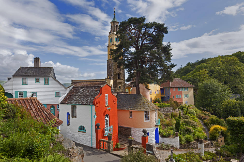 <p>This coastal Welsh town was designed and built in the style of an Italian village, so you'll feel like you're abroad when visiting. Home to the iconic Portmeirion dinnerware range, you can shop the brand's goods while taking in the scenery. Experience the village in all its glory during Festival No. 6 – the village's annual music, arts and culture festival – where you can listen to music, talks, and sample delicious food. <em>[Photo: Getty]</em> </p>