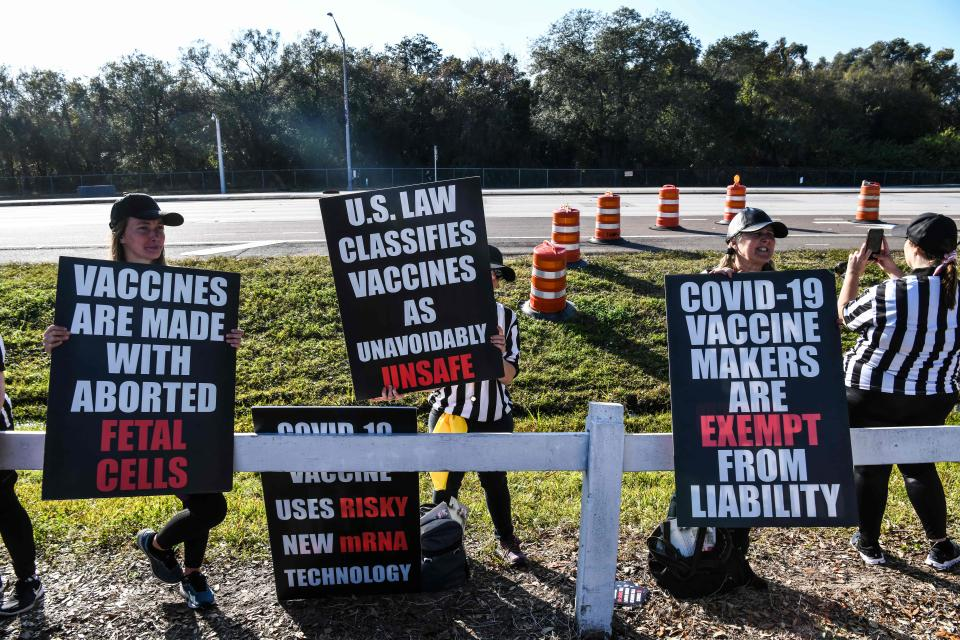 People protest against the covid-19 vaccine outside of the Raymond James Stadium prior to the Super Bowl match between Kansas City Chiefs and Tampa Bay Buccaneers in Tampa, Florida on February 7, 2021. (Photo by CHANDAN KHANNA/AFP via Getty Images)