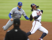 Toronto Blue Jays Cavan Biggio tags Atlanta Braves baserunner Ronald Acuna out in a run down as he is caught off base attempting to steal second during the first inning in a baseball game on Wednesday, Aug. 5, 2020, in Atlanta. (Curtis Compton/Atlanta Journal-Constitution via AP)