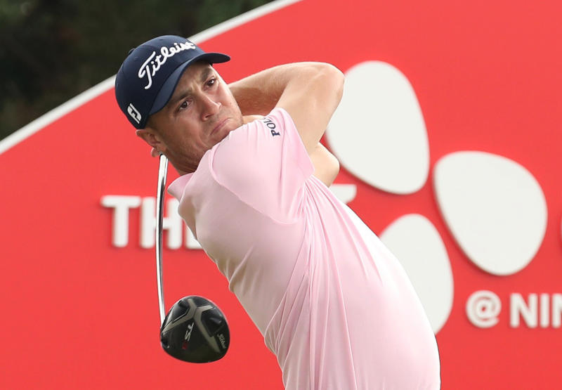 Justin Thomas of the United States watches his shot on the 18th hole during the final round of the CJ Cup PGA golf tournament at Nine Bridges on Jeju Island, South Korea, Sunday, Oct. 20, 2019. (Park Ji-ho/Yonhap via AP)