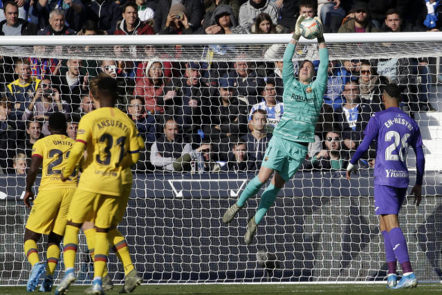 Barcelona's goalkeeper Marc-Andre ter Stegen makes a save during a Spanish La Liga soccer match between Leganes and FC Barcelona at the Butarque stadium in Madrid, Spain, Saturday Nov. 23, 2019. (AP Photo/Paul White)