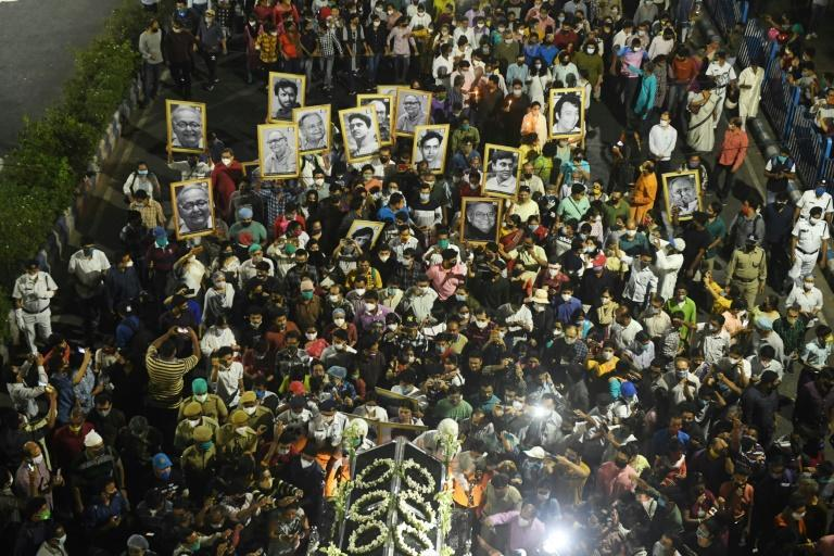 Thousands of mourning fans gathered in Kolkata near the crematorium where Soumitra Chatterjee's body was taken late on Sunday, carrying candles and photographs of the actor
