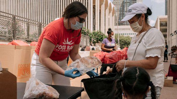 PHOTO: New Yorkers in need receive free produce, dry goods, and meat at a Food Bank For New York City distribution event at Lincoln Center on July 29, 2020, in New York City. (Scott Heins/Getty Images)