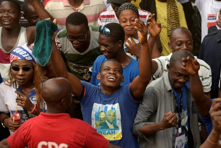 Supporters of George Weah celebrate after final results in Liberia's presidential election confirmed his as winner