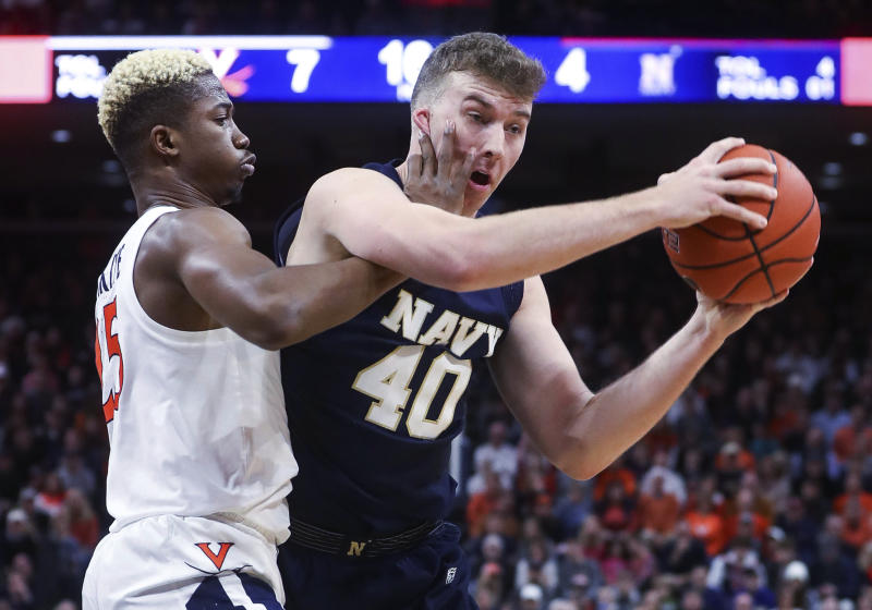 Navy center Evan Wieck (40) is defended by Virginia forward Mamadi Diakite (25) during an NCAA college basketball game in Charlottesville, Va., Sunday, Dec. 29, 2019. (AP Photo/Andrew Shurtleff)
