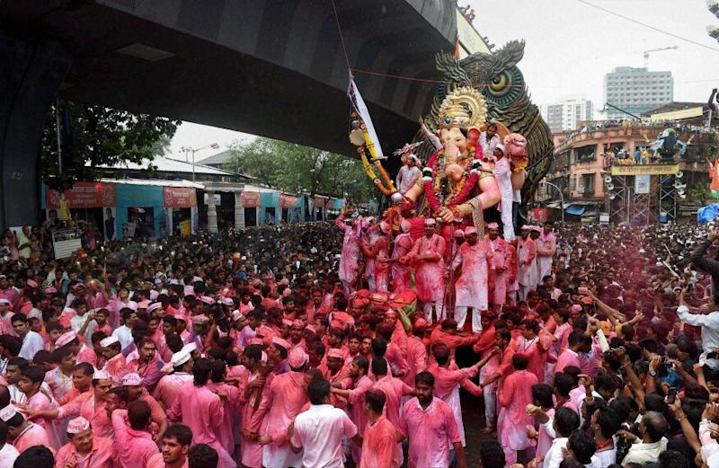 A majority of the mandals will have subdued celebrations with small, manageable idols as there will be no huge processions or the elaborate immersion ceremonies at seafronts or other water bodies, as decided by the government. (Image: PTI)