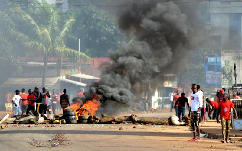 Protesters burn tyres as they demonstrate in Conakry - AFP