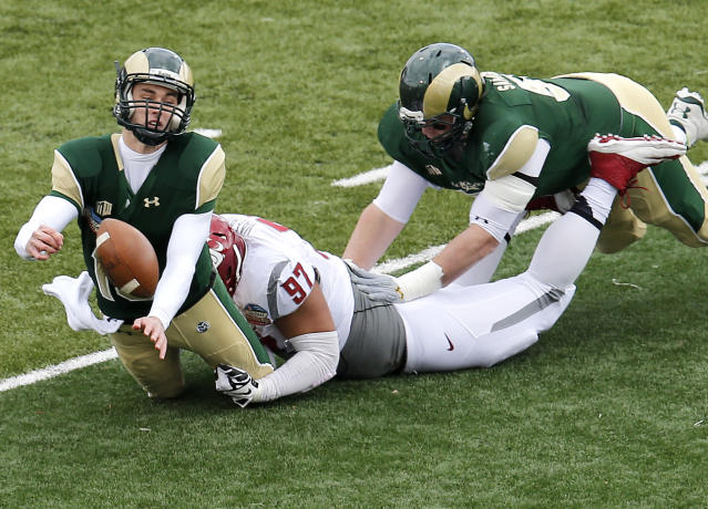 Colorado State quarterback Garrett Grayson is sacked by Washington State defensive lineman Destiny Vaeao (97) as Colorado State's Johnny Schupp tries to block during the first half of the New Mexico Bowl NCAA college football game, Saturday, Dec. 21, 2013, in Albuquerque, N.M. (AP Photo/Matt York)