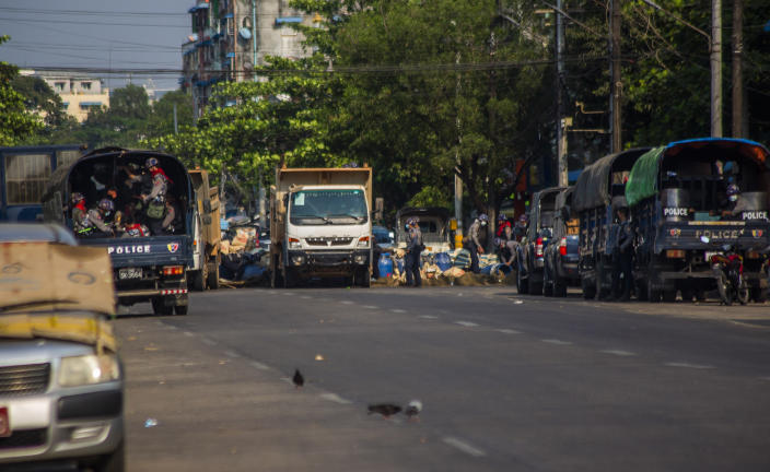 Soldiers and police use trucks to remove improvised barricades set up by anti-coup protesters and residents to secure a neighborhood from security forces in Yangon, Myanmar, Thursday, March 18, 2021. (AP Photo)