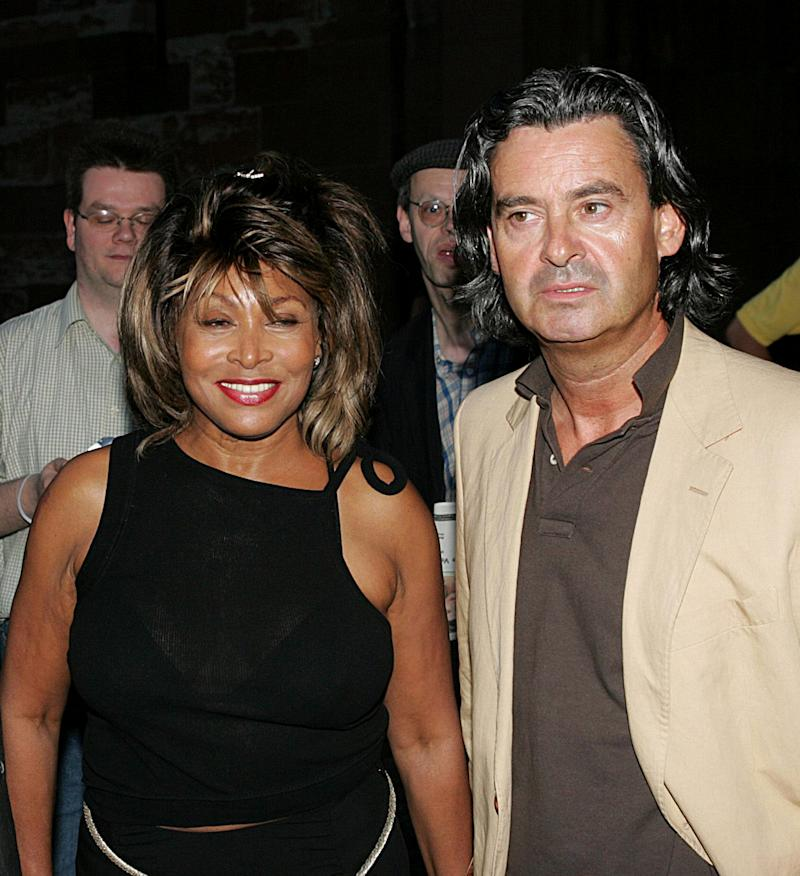 FILE - In this July 28, 2005 file picture US singer Tina Turner and her German partner Erwin Bach, right, arrive at a Gala in Basel, Switzerland. Legendary rock singer Tina Turner has married her longtime German beau, Erwin Bach, in a Swiss civil ceremony. The mayor of Kuesnacht, the wealthy Zurich-area community where Turner lives, says that she and Bach, a music executive, were married several weeks ago at the registry office. Markus Ernst told The Associated Press on Thursday, July 18, 2013, it was a routine ceremony, ahead of a private celebration on Sunday July 21, 2013 at the couple's home. (AP Photo/Keystone/Patrick Straub,File)