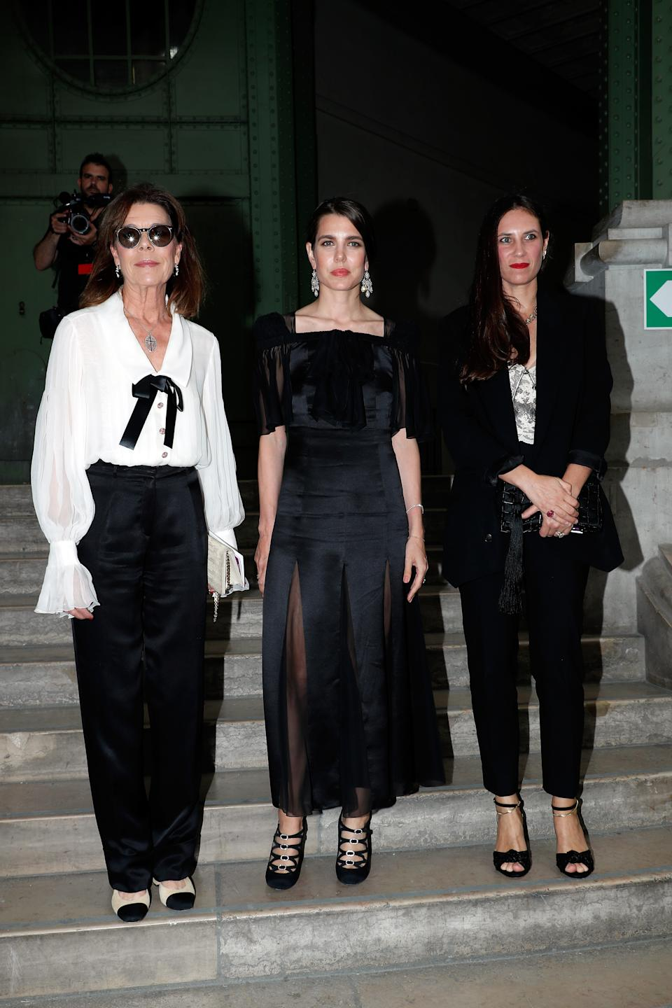 "PARIS, FRANCE - JUNE 20: Caroline de Hanovre, her daughter Charlotte Casiraghi Rassam and her daughter in Law Tatiana Santo-Domingo Casiraghi attend ""Karl for Ever"" Tribute to Karl Lagerfeld  at Grand Palais on June 20, 2019 in Paris, France. (Photo by Bertrand Rindoff Petroff/Getty Images)"