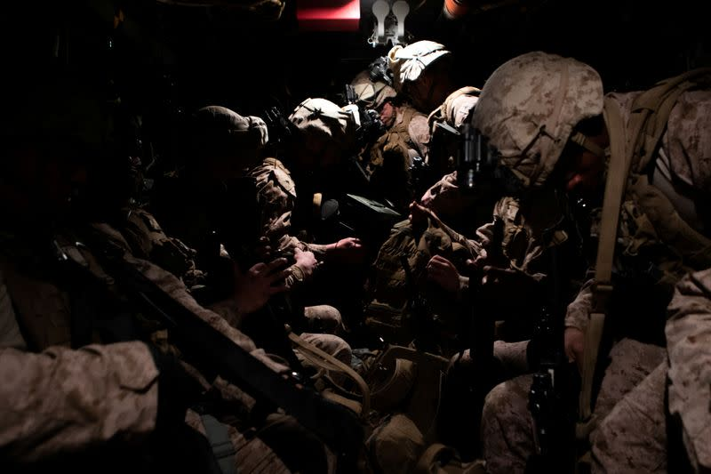 U.S. Marines assigned to Special Purpose Marine Air-Ground Task Force-Crisis Response-Central Command 19.2 prepare to deploy to reinforce Baghdad's U.S. embassy from a base in Kuwait