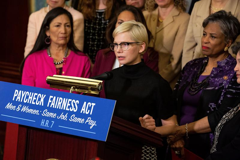 Actress Michelle Williams, center, speaks during a news conference for Equal Pay Day in Washington, D.C., U.S., on Tuesday, April 2, 2019. Women in the U.S. earn on average 81 percent of what men do, a fact commemorated Tuesday by what's come to be called 'EqualPayDay' -- the day to which a woman has to work to earn as much as a man did in the previous year. Photographer: Anna Moneymaker/Bloomberg via Getty Images