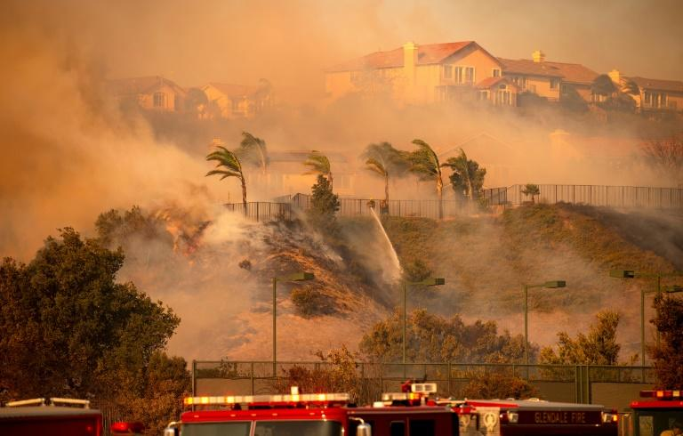 Wind whips through the area as firefighters fight impending flames during the Saddleridge fire in the Porter Ranch section of Los Angeles, California on October 11 (AFP Photo/Josh Edelson)